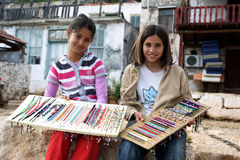 Turkish girls with a colourful display of jewellery at Kalekoy in Turkey. Royalty Free Stock Image