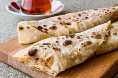 Turkish Gozleme with tea. Traditional fast food Stock Photography