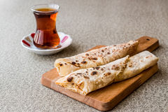 Turkish Gozleme with tea. Traditional fast food Stock Images