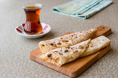Turkish Gozleme with tea. Traditional fast food Royalty Free Stock Photography