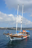 Turkish Gulet yacht, Malta. A Turkish Gulet type yacht at sea off of the coast of Malta.  The Gulet is a traditional design of a two-masted wooden sailing Stock Image