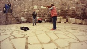 Turkish gypsies play music on different instruments live sound in courtyard of citadel Hisar  tourists walk listen Ankara. Ankara capital of Turkey Cityscape stock video footage