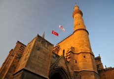 A Turkish half-moon symbols and flags of Turkey. Selimiye Mosque, former Saint Sophia Cathedral. Nicosia, Northern Cyprus Royalty Free Stock Photo