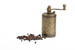 turkish hand mill with allspice Royalty Free Stock Photos