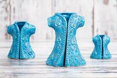 Turkish Handmade  Symbolic Ceramic Figurines on White Wooden Bac Royalty Free Stock Image