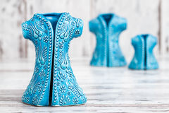 Turkish Handmade  Symbolic Ceramic Figurines on White Wooden Bac Stock Images