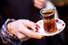 Turkish hospitality. Offering tea at lunch royalty free stock image