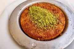 Turkish Künefe, Hot and Cheesy Southeastern Dessert. Close up Turkish Künefe, Hot and Cheesy Southeastern Dessert stock images