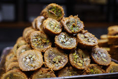 Turkish kadayif baklava sweet made with honey and pistachio nuts. Close. Laid in the shape of a pyramid or a hill Royalty Free Stock Photography