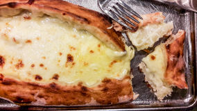 Turkish Karadeniz Pide with Melted Cheese on tray. Royalty Free Stock Image
