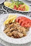 Turkish kebab with french fries and tomatoes Stock Photos