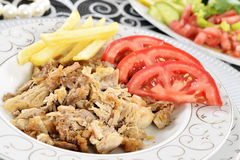 Turkish kebab with french fries and tomatoes Stock Photo