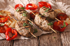 Turkish kebab with grilled vegetables close-up on the table. Hor. Izontal, rustic Royalty Free Stock Image