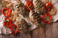 Turkish kebab with grilled vegetables close-up on the table. Hor. Izontal view from above Royalty Free Stock Photos