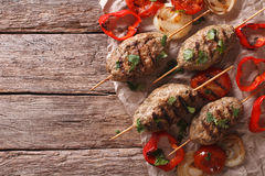 Turkish kebab with grilled vegetables on the table. Horizontal t. Turkish kebab with grilled vegetables on the table. Horizontal view from above Stock Images