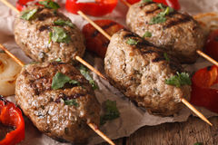 Turkish kebab with grilled vegetables on a table macro. Horizont. Al, rustic Stock Images
