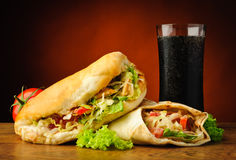 Turkish kebab, shawarma and cola drink. Still life with traditional turkish doner kebab, shawarma and cola drink stock images