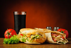 Turkish kebab and shawarma. Still life with traditional turkish kebab, shawarma, vegetables and cola stock images