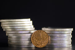 Turkish Kurush Gold Coin in front Silver Coins. On black background royalty free stock photography