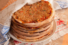 Turkish lahmacun (arab pizza) on plate. Pile of turkish lahmacun (arab pizza) on plate Royalty Free Stock Photo