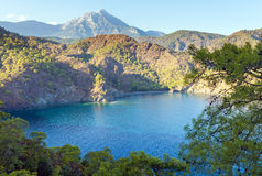 Turkish landscape with Olympos mountain, beach and green forest Royalty Free Stock Photo