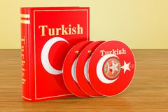 Turkish language textbook with flag of Turkey and CD discs on th. E wooden table. 3D Stock Image