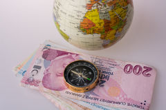 Turkish Lira banknotes by the side of a compass Royalty Free Stock Photography