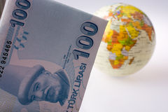 Turkish Lira banknotes by the side of a model globe Stock Photos