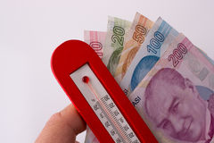 Turkish Lira banknotes by the side of a red color temperature Stock Images