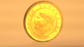 1 Turkish Lira Coin. Close-up view of one lira coin of Turkey isolated in yellow background stock footage
