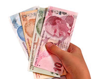 Turkish lira held on a white background Stock Photo