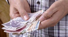 Turkish lira man counting Stock Images