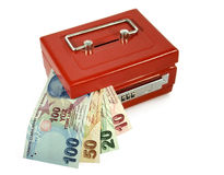 Turkish lira in moneybox. Turkish lira banknotes coming out from red moneybox Stock Photography