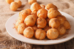 Turkish lokma donuts with honey and cinnamon close-up. horizonta Stock Photo