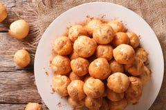 Turkish lokma donuts with honey and cinnamon close-up. horizonta Royalty Free Stock Photography