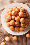 Turkish lokma donuts with honey and cinnamon close-up. Vertical Stock Photos