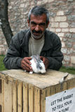 A Turkish man with his rabbit in Istanbul in Turkey. Royalty Free Stock Image