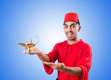 Turkish man with lamp on white Royalty Free Stock Photos