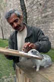 A Turkish man and rabbit in Istanbul in Turkey. Stock Photography