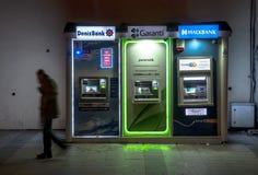 turkish man walking next to ATM Royalty Free Stock Images