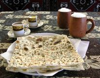 Turkish meal. Typical afternoon snack in Eastern Anatolia: ayran (salty yoghurt), gözleme (pancakes) and coffee (with thick grounds Stock Photo