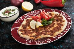 Turkish meat pizza. Lahmacun, turkish meat pizza with tomato, lemon and yogurt Stock Images
