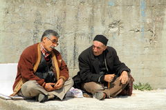 Turkish men chatting. Sitting at a wall Stock Photos