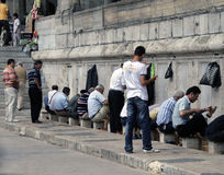 Turkish men doing ritual ablutions washing before enter the mosque for pray Royalty Free Stock Photography