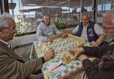 Turkish Men Playing Rummy Tile Game Near the Seaside Stock Photos