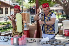 Turkish men selling traditional turkish icecream on a street in. SIDE, TURKEY - april 19, 2012: Turkish men in turk costumes  selling traditional turkish Stock Images