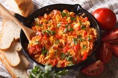 Turkish Menemen omelet close-up in a frying pan. Horizontal Royalty Free Stock Image