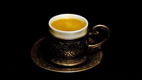 Turkish metal coffee cup on black background. stock video footage