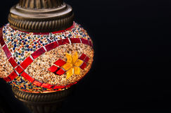 Turkish and middle east lamp. Turkish lamp on a black background with copy space Royalty Free Stock Image