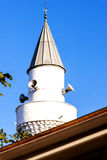 Turkish minaret in blue sky Royalty Free Stock Photo